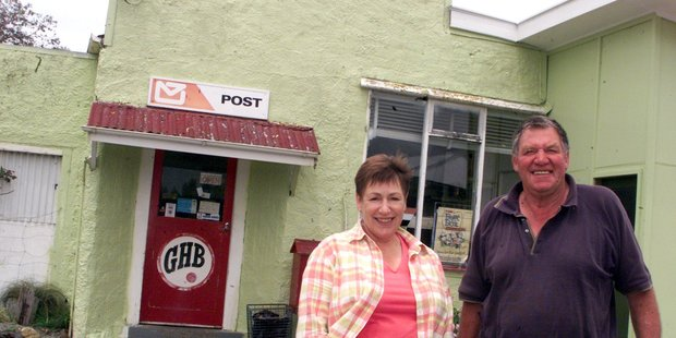 Eric Bird, with his wife Jan Bird, outside the old Mangamaire Store, which they closed in 2003. PHOTO/FILE