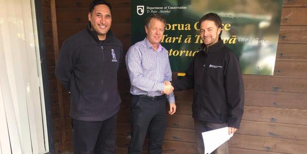 Rotorua Trails Trust Chairman Gregg Brown with DOC Operations manager Jeff Milham alongside trustee Eugene Kara.  PHOTO/SUPPLIED