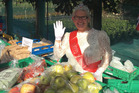 A reader went to the Takanini farmers market yesterday morning and was delighted to spot the Queen selling vegetables on her birthday weekend. Photo / Supplied