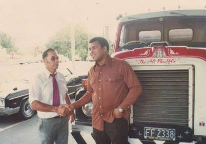 "Te Mana Tipene meets Muhammad Ali in Auckland in 1979 in front of Mr Tipene's truck ""The Ali Shuffle""."