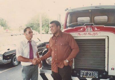 "Te Mana Tipene meets Muhammad Ali in Auckland in 1979 in front of Mr Tipene's truck ""The Ali Shuffle""."