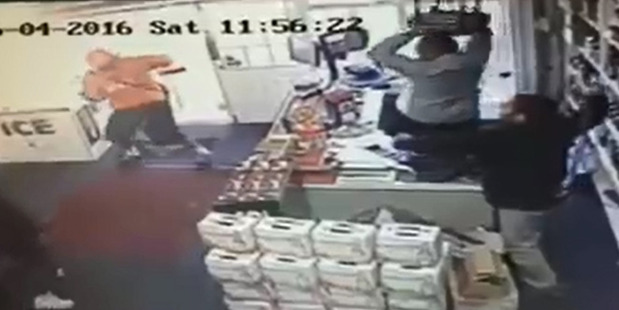 Loading Security footage showing an attempted robbery at Mitchell Downs Liquor Centre around lunch time yesterday.