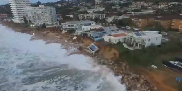 Loading Drone footage shows the damage to beachfront properties. Photo / Supplied