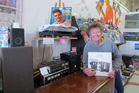 Tony Ward with a copy of Right First Time by Th' Dudes, recently signed by former band member Dave Dobbyn.