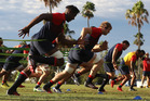 Maro Itoje sprints with team mates during the England training session on the Gold Coast. Photo / Getty