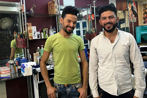 Arkan Ismael and Mohammed Sultan at the Hajar barbershop. Photo / Washington Post