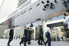 Land, Infrastructure, Transport and Tourism Ministry officials enter the headquarters office of Mitsubishi Motors in Tokyo, Japan. Photo / Japan News