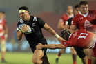 Jonah Lowe of New Zealand slips a tackle made by Aleksandre Merkvilishvili of Georgia. Photo / Getty