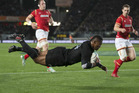 All Blacks winger Waisake Naholo scores the first of his two tries. Photo / Brett Phibbs