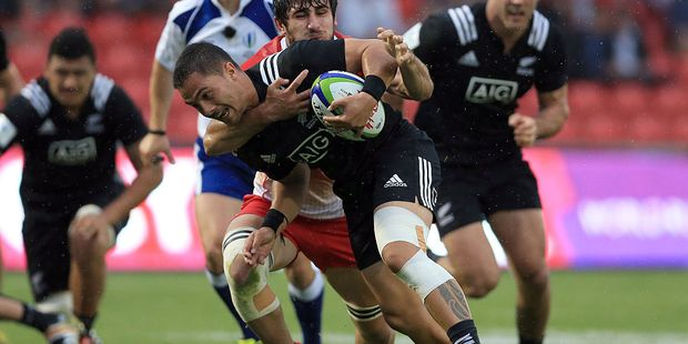 Sam Nock of New Zealand is tackled by Giorgi Tsutskiridze of Georgia during a World Rugby U20 Championship match. Photo / Getty