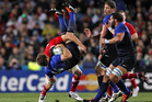 France's Vincent Clerc is taken in a high tackle by Wale's Sam Warburton. Photo / Dean Purcell