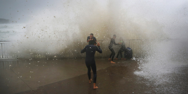 Local children are soaked by huge waves at Bronte Beach. Photo / Getty Images