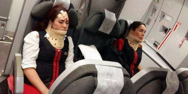 This image of two flight attendants sitting at the back of their aircraft in neck braces was uploaded to Twitter shortly after the flight. Photo / TrafficAirColom Twitter