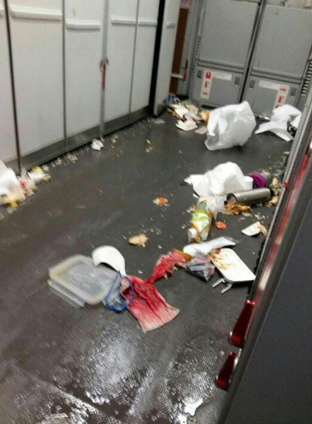 Blood-stained tissue sits among food and containers that were thrown from their positions during the violent turbulence. Photo / TrafficAirColom Twitter
