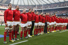 Wales players stand for their anthem ahead of a clash against England. Photo / Getty