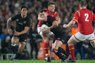 Ryan Crotty tries to break past Welsh halfback Rhys Webb during the All Blacks opening test against Wales. Photo / Greg Bowker