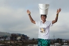 Faustinah Ndlovu is walking 21km with a bucket of water on her head to raise money for a school in her native Zimbabwe.