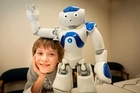 Two humanoid robots visited the House of Science in Tauranga to show scientists, students and the public just how advanced robotics has become. This little guy can dance, play soccer, talk, snap his fingers and more.