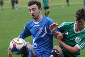 Tauranga City United's Harry Gawrty (blue) battles with Onehunga Sports' Sean Cooper at Links Avenue on Sunday. Photo / Stuart Whitaker