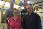Back, Kelly Webber, left, the retiring contract manager at AMP Wai Splash and Brian Beale, chairman of the Tararua Aquatic Community Trust (TACT). Front, Kendyl Paget, left, new TACT aquatics manager and Peter Wimsett TACT treasurer.