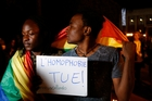 There have been vigils around the world for the victims of the attack, including outside the Moroccan Parliament in Rabat, where one couple held a sign that reads l'homophobie tue, or homophobia kills. Picture / AP