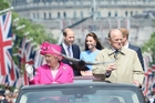 The Queen and Prince Philip will go head to head with their son and daughter-in-law. Photo / AP