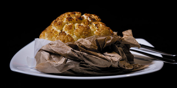 The fourth course - cauliflower presented in a brown paper bag. Photo / Dean Purcell