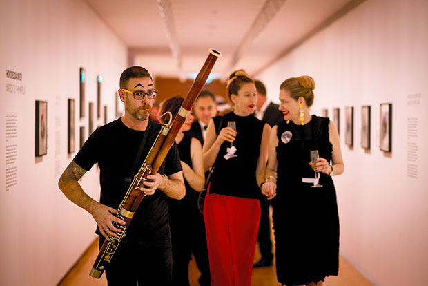 Ben Hoadley on bassoon leads guests, including gallery director Rhana Devenport (right) to dinner. Photo / Dean Purcell