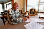 Percy Blundell fills in his application form for a chance to be part of the Battle of Long Tan's 50th commemorations in Canberra this August. Photo / John Stone