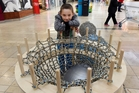 Haven Byrne, 9, helped to knit the net, which was being made into a seat for the World Wide Knit in Public Day at Bayfair. Photo / George Novak