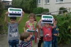 Syrian children with the country's flag at the refugee resettlement centre in Mangere. Photo / Simon Collins