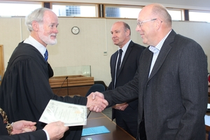 Judge Gregory Ross (left), welcomes new JPs, Dawid de Villiers of Dannevirke and John Arends, Pahiatua, following their oath and affirmation.