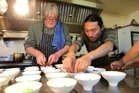 Chefs Kent Baddeley and Masanori Takahashi, prepare some