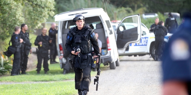 STANDOFF: An Armed Offenders Squad member during an armed standoff in Frasertown earlier this year. PHOTO/DUNCAN BROWN