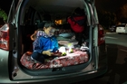 Setima Autagavaia, 4, in the back of his family vehicle in solidarity for people sleeping rough. Picture / Jason Oxenham