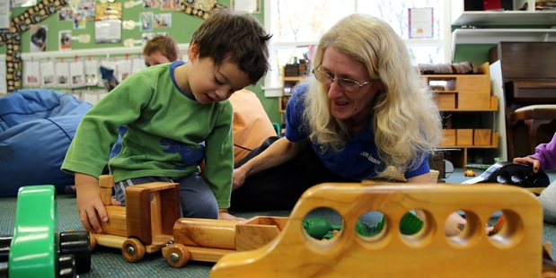 ROLL ON: Connor McLean, 3, has a go with the new train donated by Lee-Anne Davies (right).PHOTO/STUART MUNRO