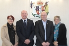 At the swearing in of two new JPs in Dannevirke on Monday, Suzanna de Villiers (left), with Dawid de Villiers JP,  Pahiatua JP Johannes (John) Arends,  and his wife Janine. Photo / Christine McKay