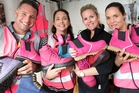 Dougie Robinson, Kate Peart-Baillie, Stacey Head and Sophia van den Bogaard from She Wear showcase the Australian company's safety and fashion footwear for women at Fieldays, being held at Mystery Creek near Hamilton. Picture / Alan Gibson