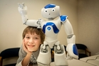 ROBO-BUDDIES: Luca Ririnui, 9, makes friends with Nao the humanoid robot .PHOTO/ANDREW WARNER