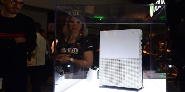 People view the new Xbox One S on display at the Los Angeles Convention Center during the second day of 2016 Electronic Entertainment Expo (E3) annual video game conference. Photo / AFP