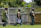 Bomb disposal officers check for bombs at an apartment complex of a suspect linked to the fatal shootings at an Orlando nightclub. Photo / AP
