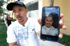 Angel Mendez, standing outside the Orlando Regional Medical Centre, holds up a photo trying to get information about his brother Jean Mendez who was at the Pulse Nightclub. Photo / AP