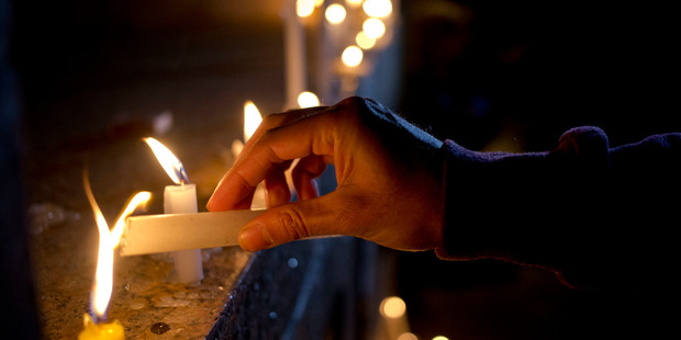 Loading A man in Santiago, Chile, lights a candle during a vigil in front of the US Embassy to remember the victims of the mass shooting at the Pulse Orlando. Photo / AP