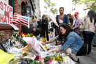 Giovanna Lopez, who says she knew several victims of the Orlando nightclub shootings, lays flowers for her friends at the historic Stonewall Inn in New York. AP photo / Kathy Willens