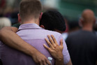 Mourners embrace during a vigil in Orlando for those killed in a mass shooting at the Pulse nightclub. Photo / AP