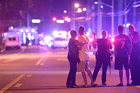 Orlando Police officers direct family members away from a fatal shooting at Pulse Orlando nightclub in Orlando. Photo / AP