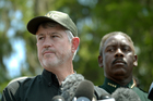 Nick Wiley, of Florida Fish & Wildlife Conservation Commission, left, and Orange County Sheriff Jerry Demings answer questions from reporters. Photo / AP