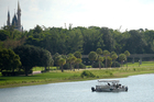 Orange County Sheriff's officers search the Seven Seas Lagoon between Walt Disney World's Magic Kingdom theme park, left, and the Grand Floridian Resort. Photo / AP