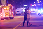 Family members wait for word from police after arriving down the street from a shooting involving multiple fatalities at Pulse Orlando nightclub in Orlando. Photo / AP