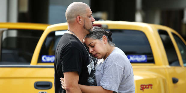 Loading Ray Rivera, left, a DJ at Pulse Orlando nightclub, is consoled by a friend, outside of the Orlando Police Department. Photo / AP